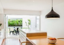 Fabulous-kitchen-and-dining-space-of-the-revamped-cottage-with-a-large-breakfast-bar-35216-217x155
