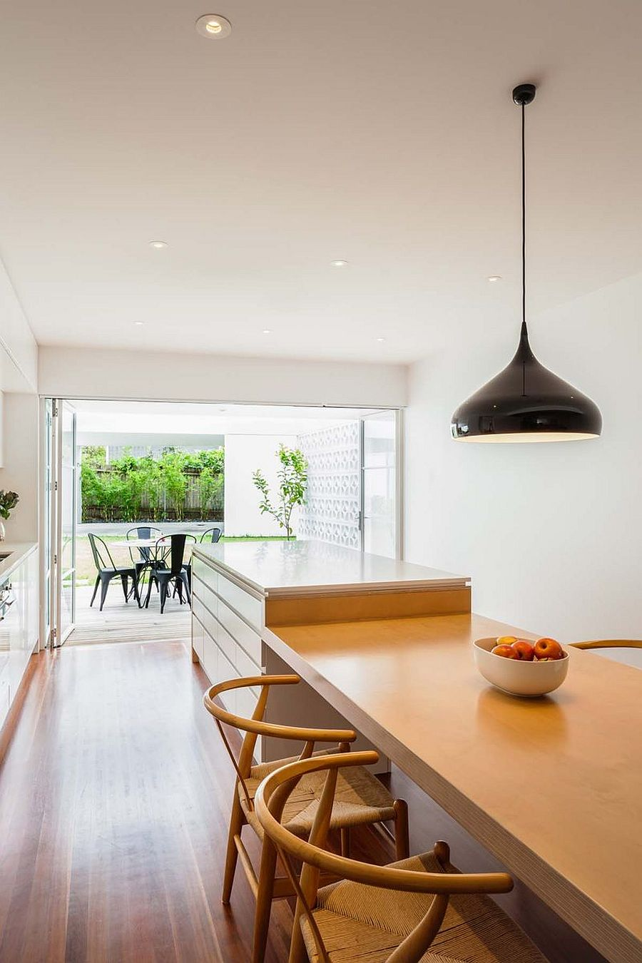 Fabulous kitchen and dining space of the revamped cottage with a large breakfast bar