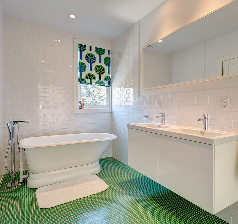 Fabulous modern bathroom in white with green-tiled floor and a window shade that elevates the color scheme