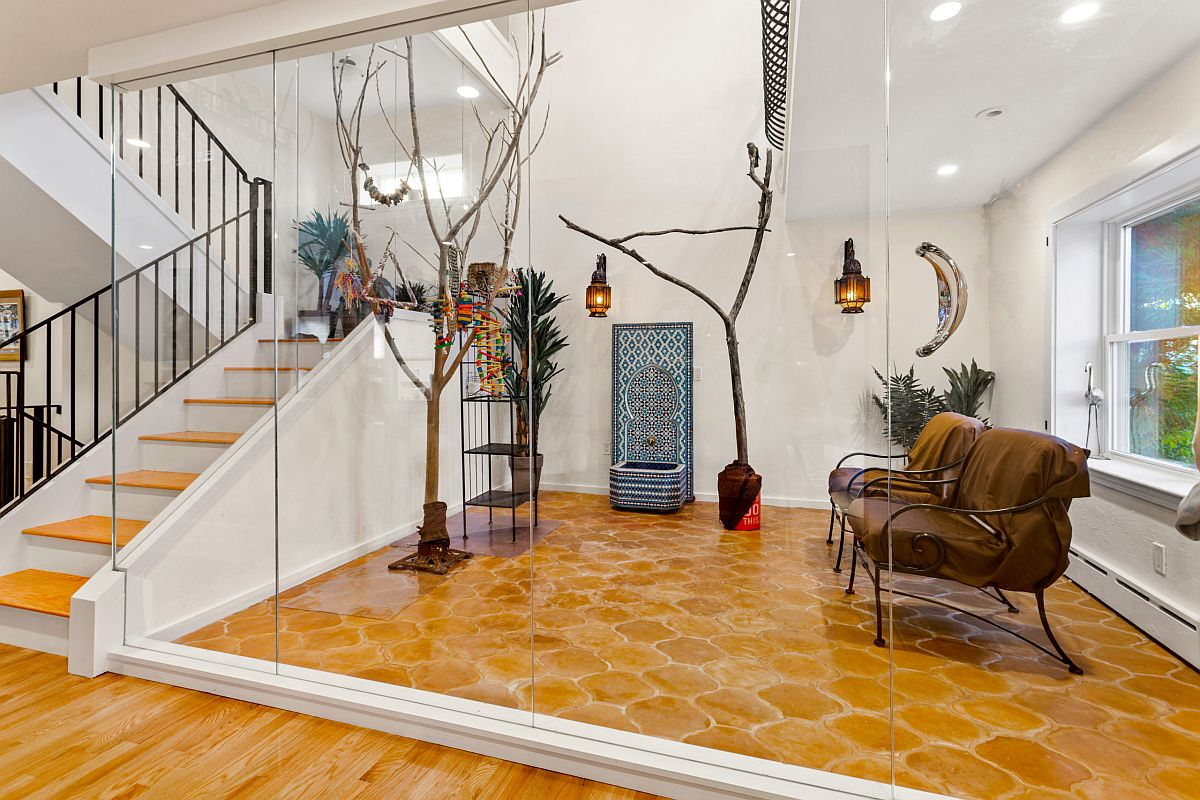 Fabulous sunroom in white with terra-cotta floor, fun decor and lantern style lighting