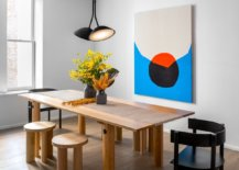 Fabulous-wooden-dining-with-barrel-legs-and-the-wall-art-piece-in-the-backdrop-make-the-biggest-impact-92075-217x155