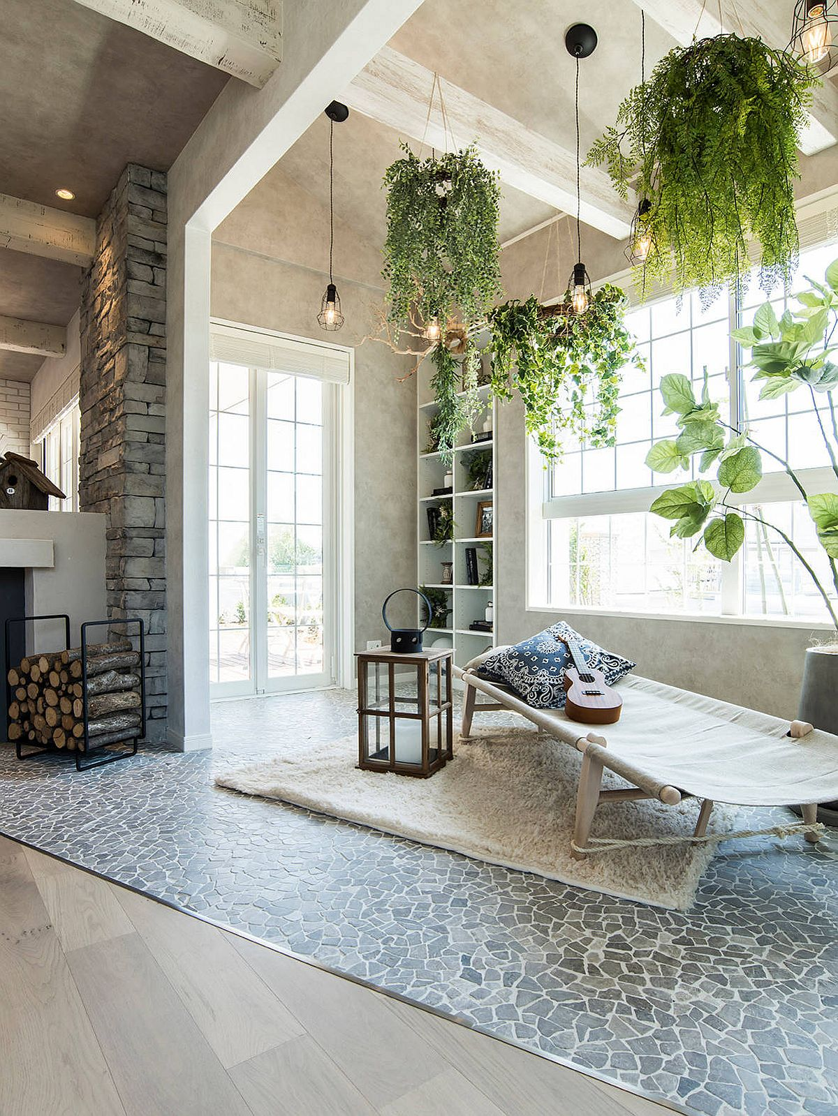 Fill the eclectic sunroom with different indoor planters to create a beautiful interior