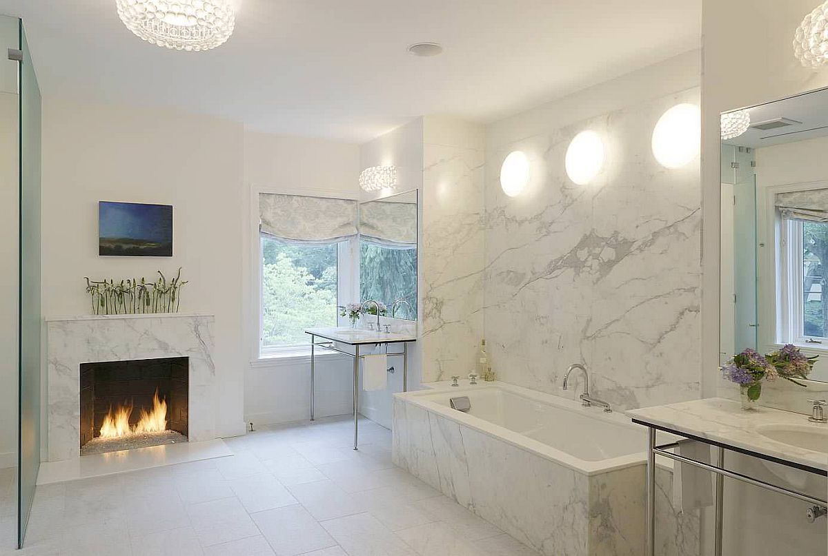 Fireplace becomes the focal point in thi monochromatic, neutral bathroom