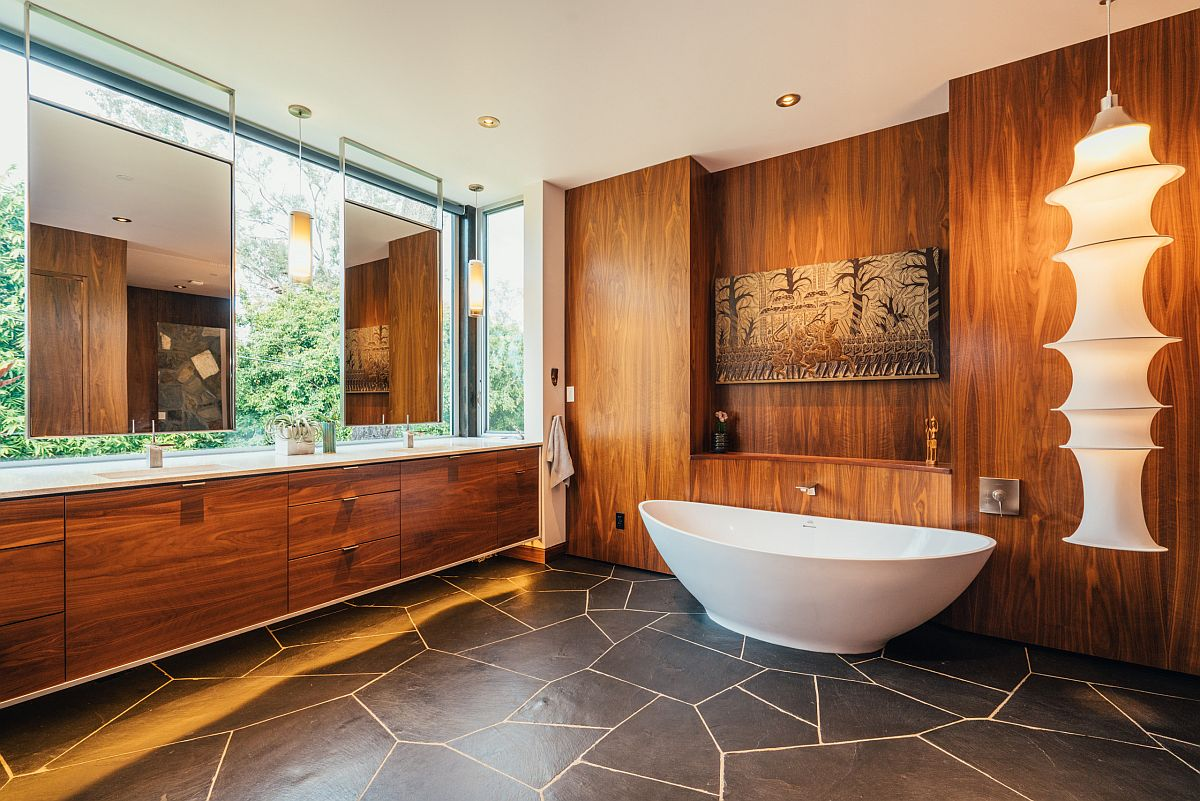 Flooring adds contrast to the bathroom in wood and white is an absolute showstopper