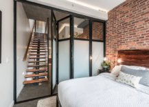 Folding-doors-and-a-neutral-backdrop-add-to-the-spacious-design-of-this-small-industrial-bedroom-with-accent-brick-wall-16720-217x155