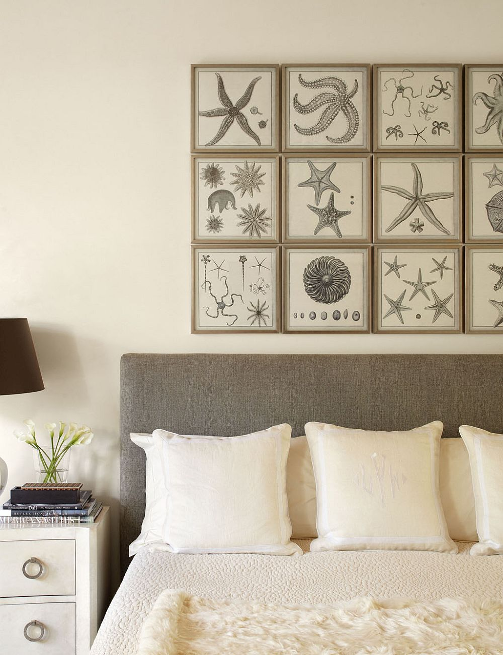 Framed natural prints serve as art work in this modern white bedroom