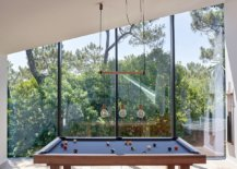 Game-room-on-the-upper-level-with-glass-walls-offers-lovely-views-of-the-landscape-outside-98928-217x155