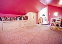 Girls-attic-playroom-with-plenty-of-built-in-shelving-and-walls-draped-in-pink-98193-217x155