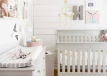 Girls-nursery-feels-refreshing-and-modern-thanks-to-its-white-and-wood-color-palette-48962-217x155