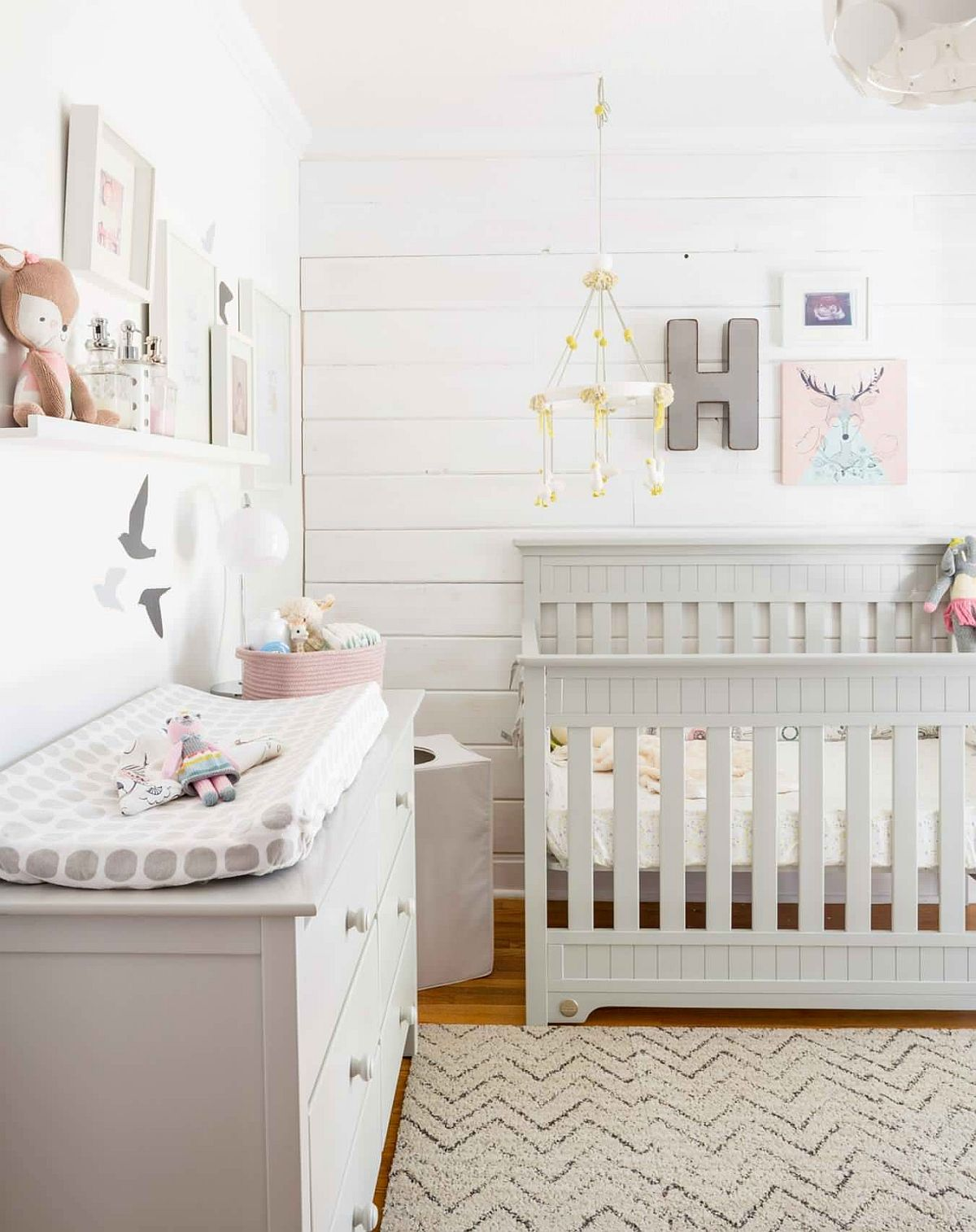 Girls' nursery feels refreshing and modern thanks to its white and wood color palette