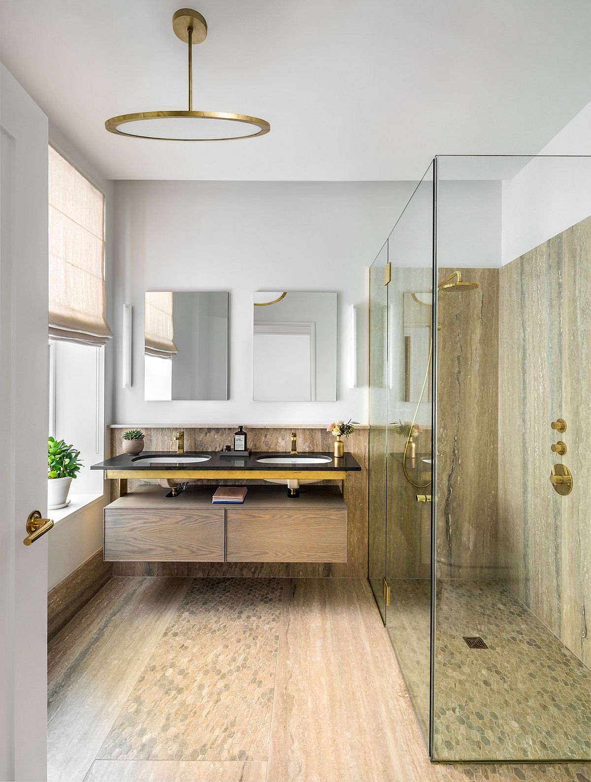 Glass shower area of the modern bathroom in white and wood