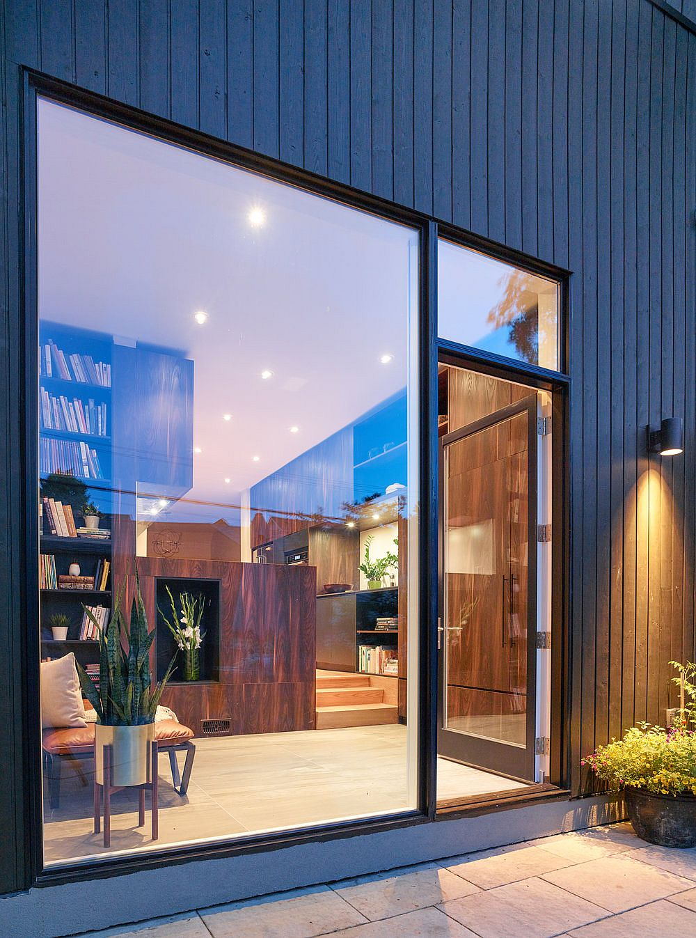 Glass windows and doors connect the interior with the new rear yard