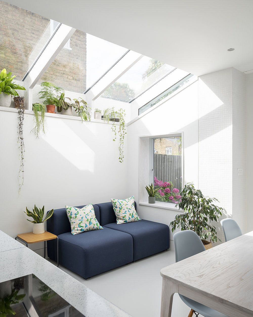 Glazed roof brings light into the new white extension to the classic Victorian terrace house