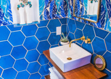Gold-mirror-with-curved-edges-in-a-blue-bathroom-23111-217x155
