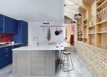 Gorgeous-blue-cabinets-add-color-and-contrast-to-the-neutral-kitchen-with-brick-walls-and-wooden-shelves-28108-217x155