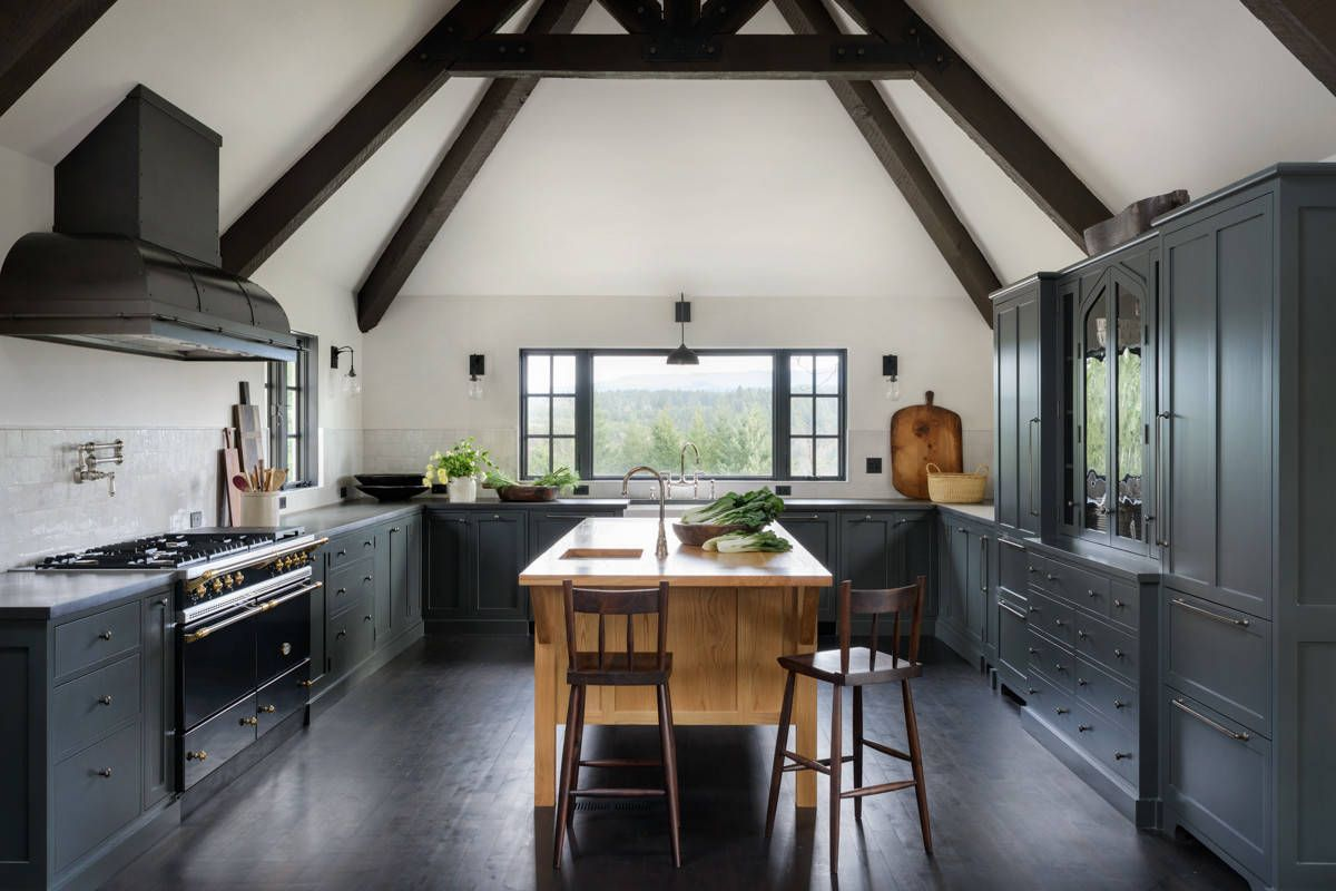 Gorgeous modern Mediterranean kitchen in black and white with floor that is dark and dashing