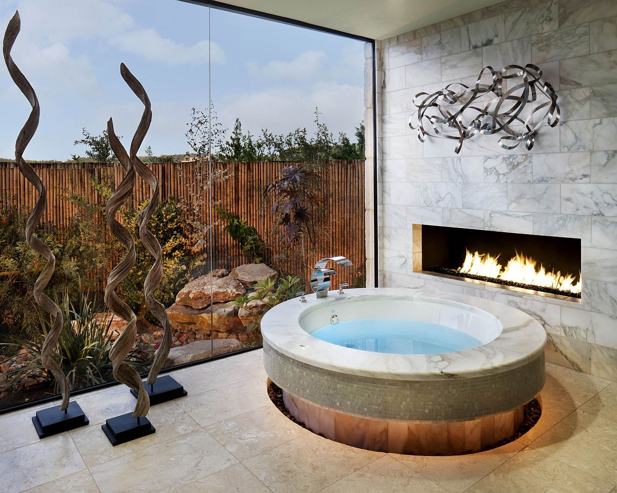 Hard to imagine a more opulent bathroom with fireplace than this!
