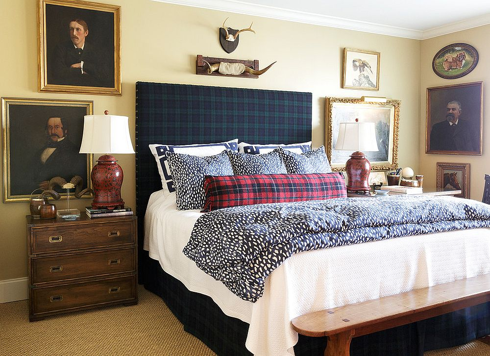 Headboard, pillows and bedding ensure there is no shortage of pattern in this Victorian-rustic bedroom