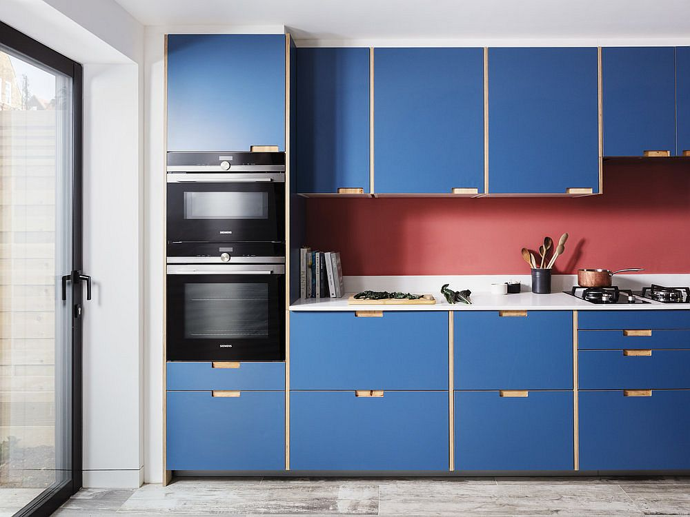 Ingenious pink backsplash also adds color to the kitchen that is already filled with blue
