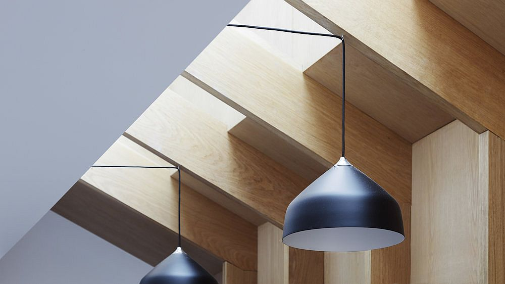 Innovative ceiling design and pendant lights bring ample ventilation into the house