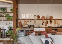 Kitchen-of-the-family-room-in-the-backdrop-uses-hooks-instead-of-usual-floating-shelves-97394-217x155