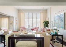 Large-and-spacious-living-area-of-the-house-with-furniture-and-wall-art-that-usher-in-color-16919-217x155