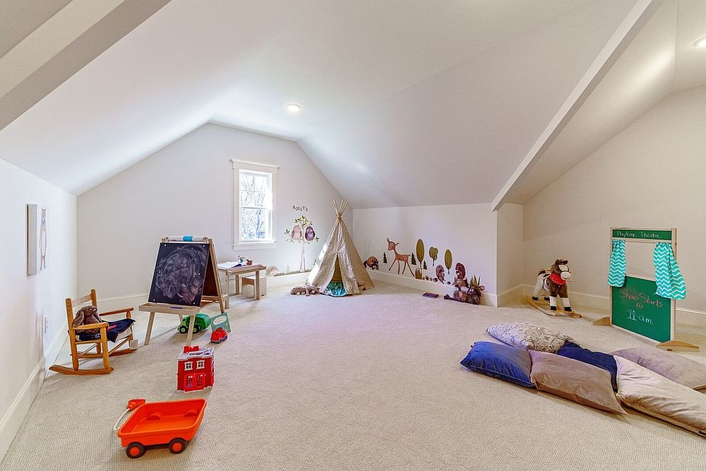 Large attic plaryroom that is carpeted feels both spacious and well-lit