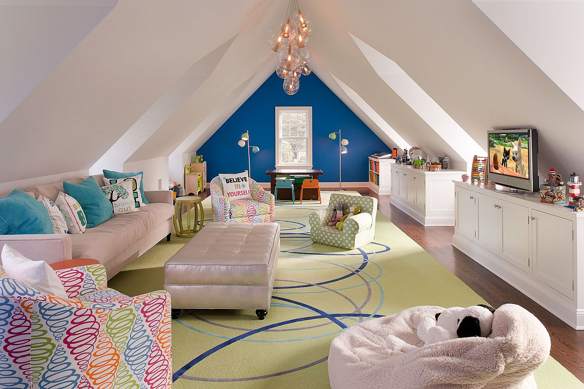 Large attic playroom in white with comfortable seating, ample space and a blue accent wall