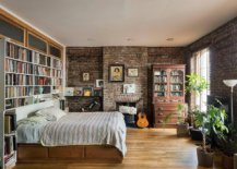 Large-bookshelf-for-the-modern-industrial-bedroom-with-brick-walls-and-a-comfy-bed-54525-217x155