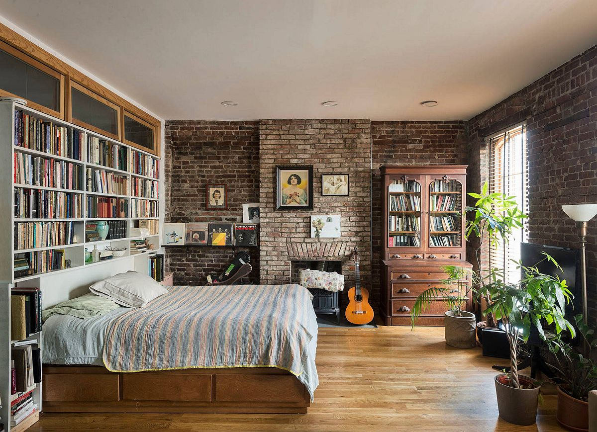 Large-bookshelf-for-the-modern-industrial-bedroom-with-brick-walls-and-a-comfy-bed-54525