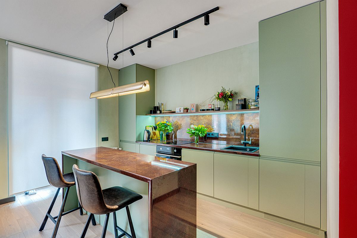 Lighter shades of green with matte finsih feel like a neutral color added to the kitchen