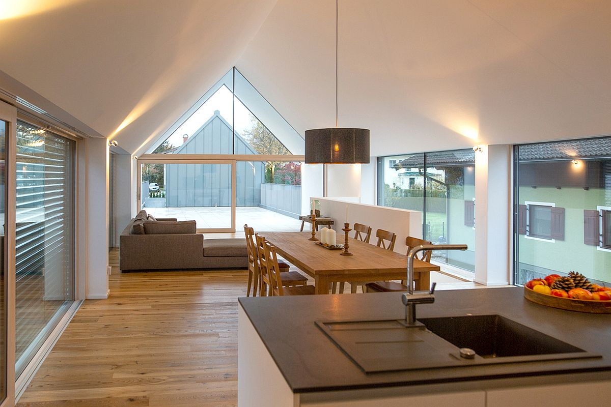 Living area, dining space and kitchen on the upper level of the two-in-one house