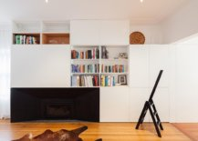 Living-area-of-the-home-with-white-walls-wooden-floor-and-accent-features-in-black-49797-217x155