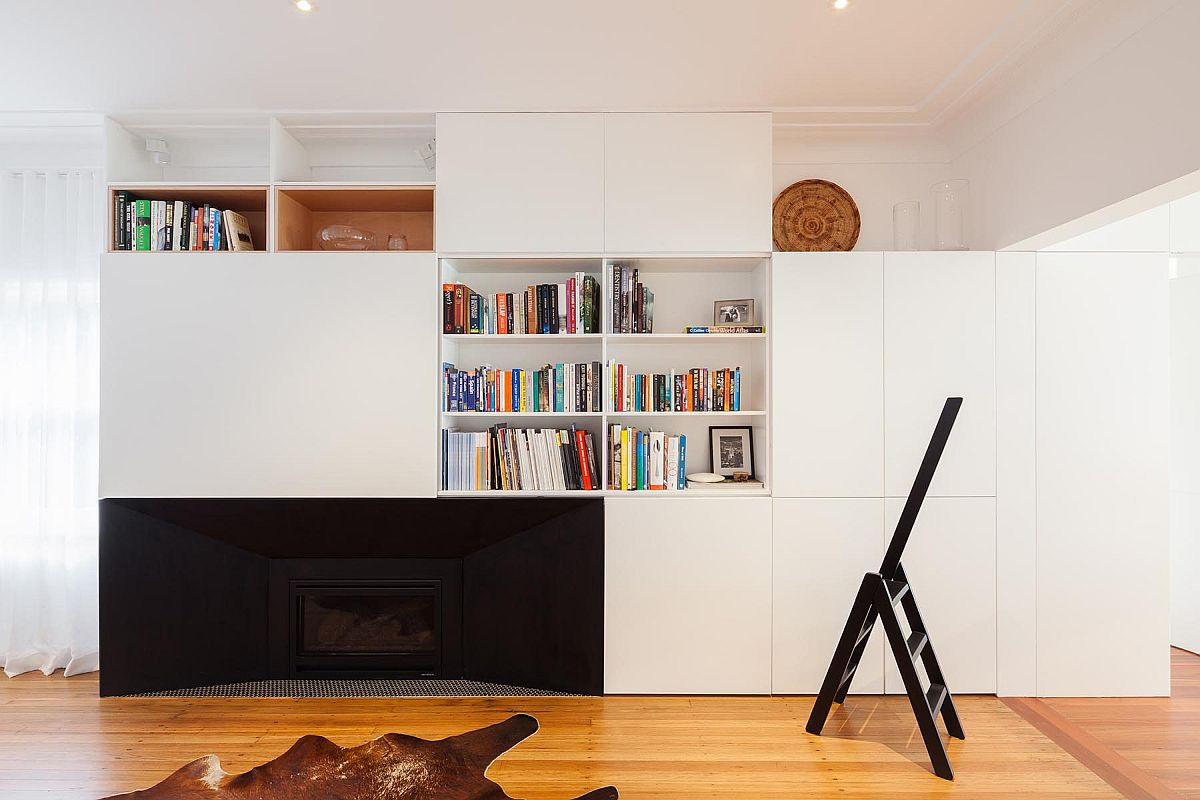 Living area of the home with white walls, wooden floor and accent features in black