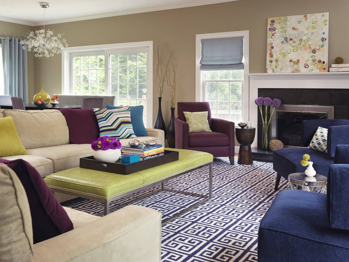 Living room with greige walls and colorful decor pieces feel charming and a touch eclectic at the same time