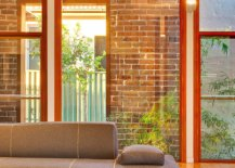 Lounge-of-Cape-Fear-House-in-Sydney-wih-brick-and-glass-wall-backdrop-21619-217x155