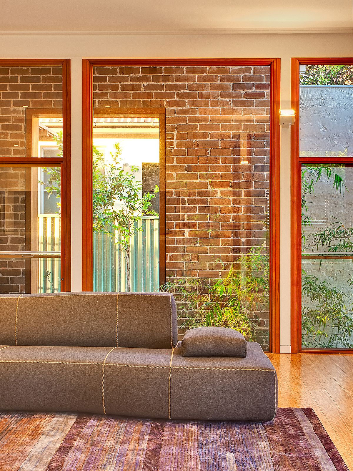 Lounge-of-Cape-Fear-House-in-Sydney-wih-brick-and-glass-wall-backdrop-21619