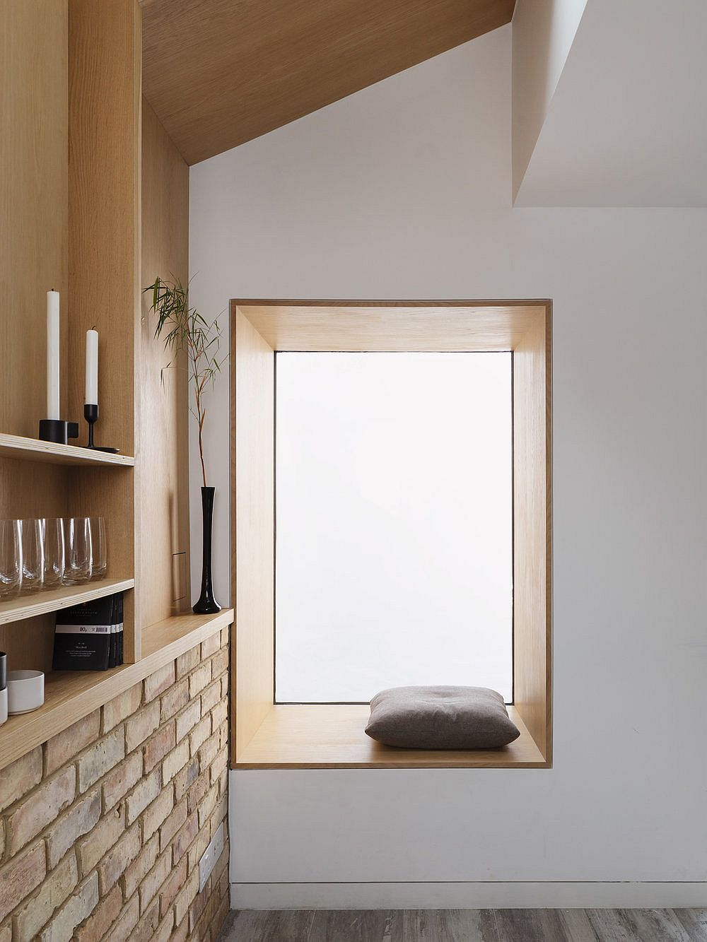 Lovely wooden window seat offers a fabulous relaxation zne within the house