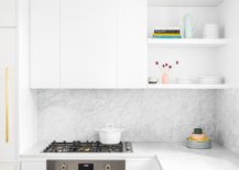 Marble-backplash-counters-and-brass-accens-create-a-unique-and-fabulous-NYC-apartment-kitchen-45138-217x155