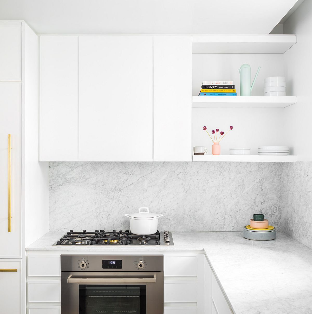 Marble backplash, counters and brass accens create a unique and fabulous NYC apartment kitchen