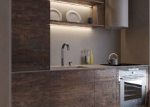 Matte-finish-of-the-kitchen-wooden-cabinets-along-with-lighting-give-it-a-cozy-appeal-52864-217x155