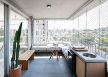 Mesh-and-glass-walls-for-the-balcony-create-a-sheltered-space-that-feels-like-an-extension-of-the-living-room-88740-217x155
