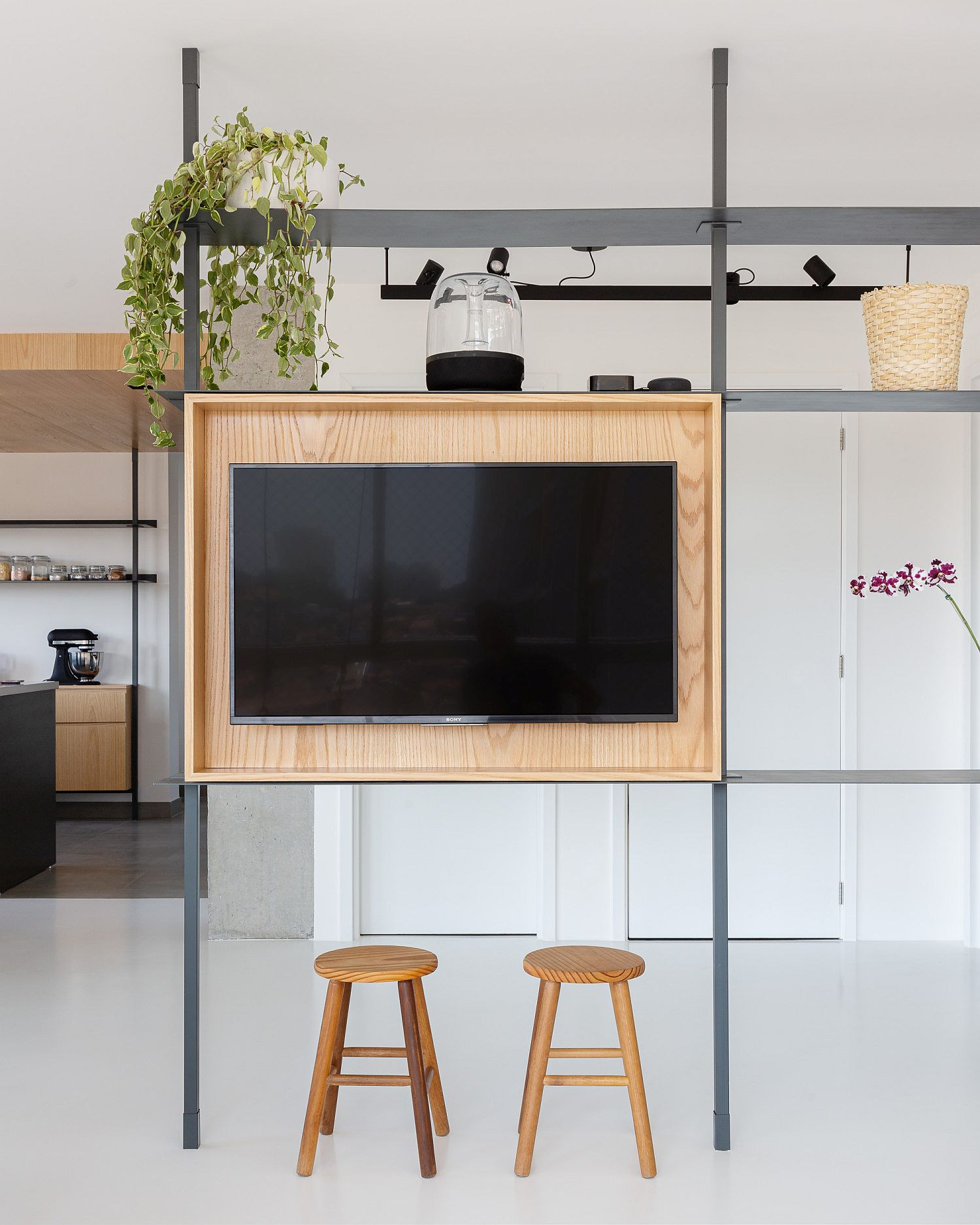 Minimal and modern room divider with TV stand and a simple, elegant frame
