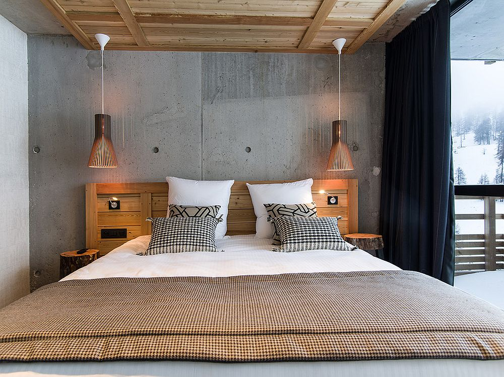 Minimal rustic bedroom with cool pendants and bedding, accent pillows that bring in a bit of pattern
