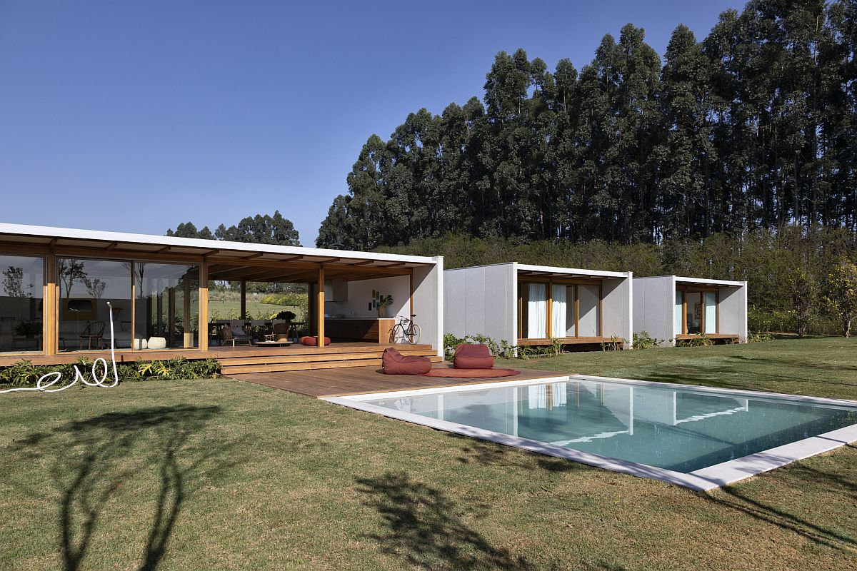 Minimal wooden deck and pool extend the interior outside withou any hassle