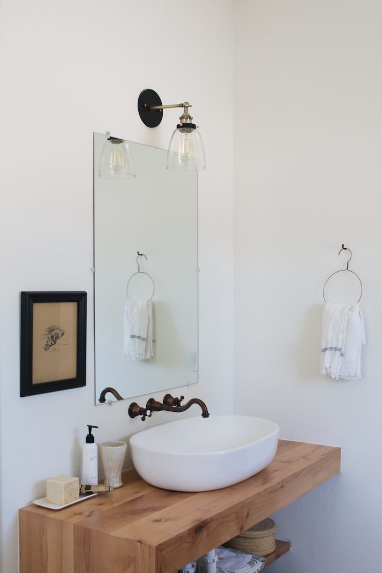 Minimalist cottage bathroom with dark and light details