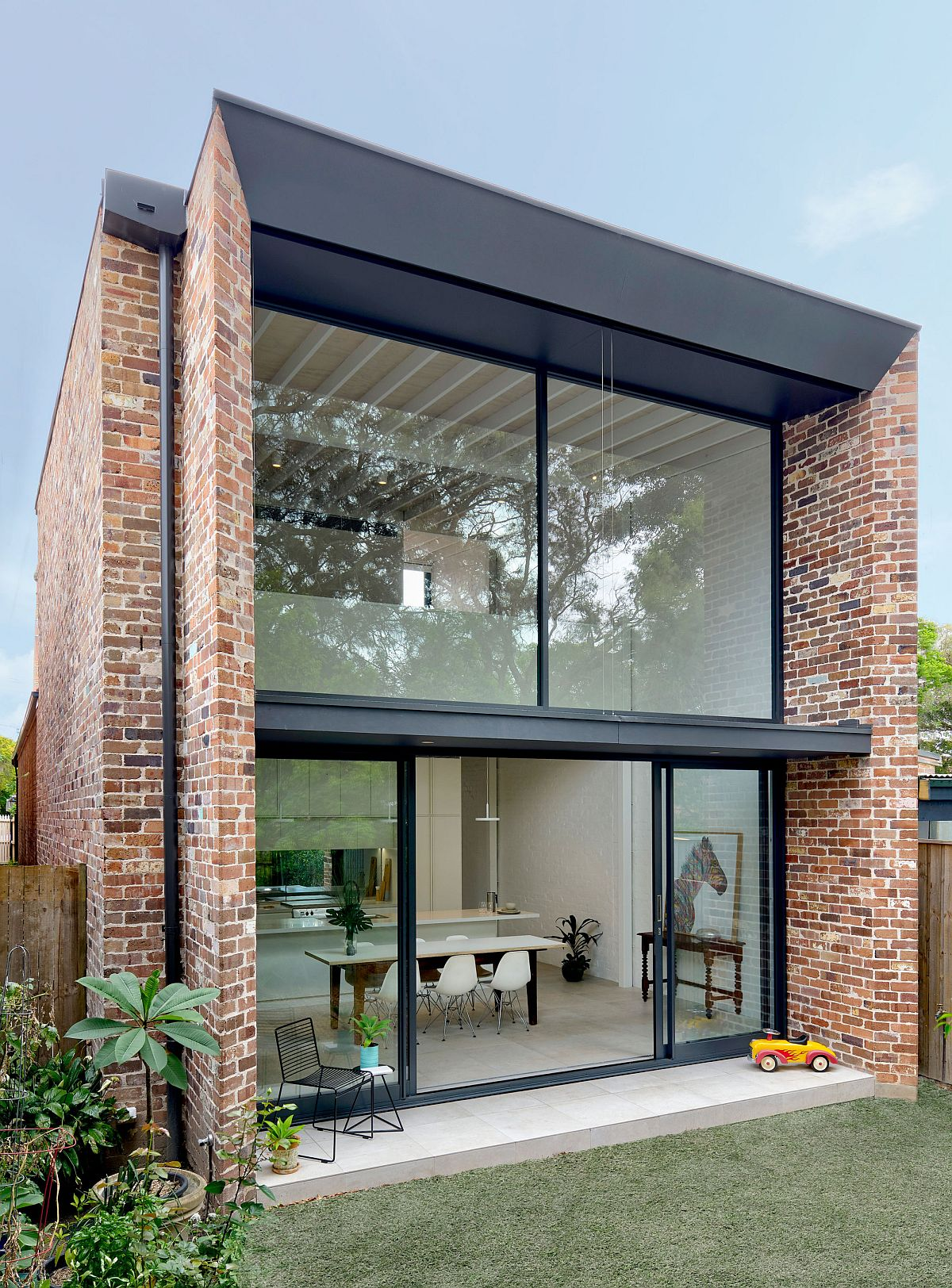 Modern extension to a classic federation-style home in Petersham, Sydney utilizes brick and glass