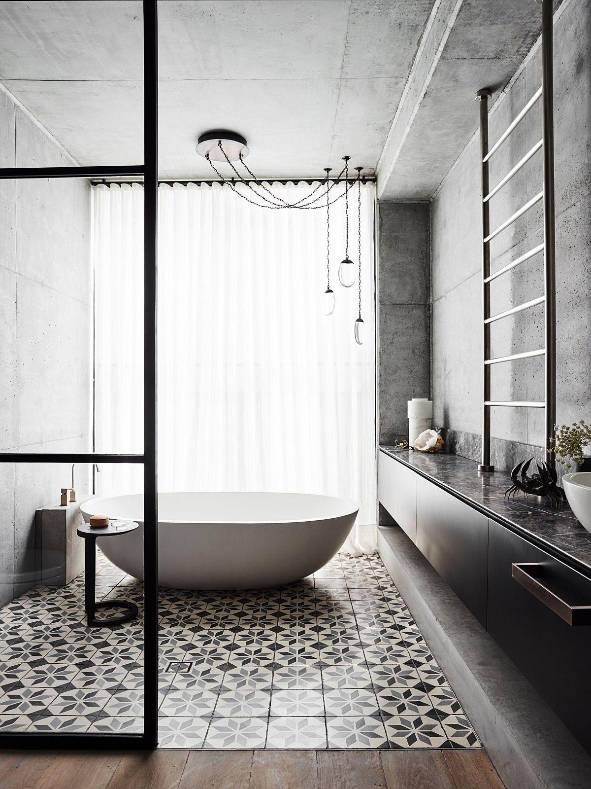 Modern minimal bathroom with industrial flair and a polished freestanding bathtub