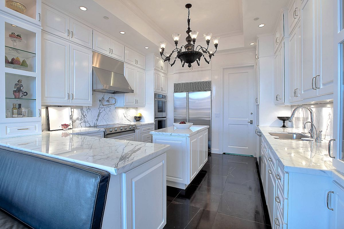 Modern transitional kitchen in white with glossy black floor and lovely lighting