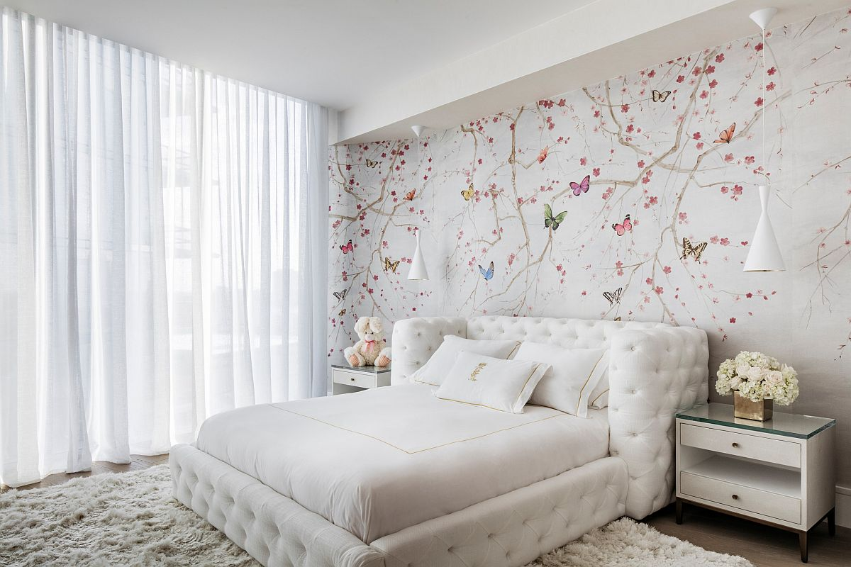 Monochromatic bedroom in white with colorful wallpaper and drapes in white